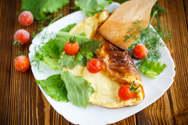 Omelette with tomatoes and lettuce Stock photo © Peredniankina