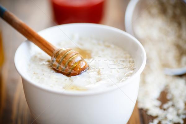 Sağlıklı kahvaltı yulaf süt bal Stok fotoğraf © Peredniankina