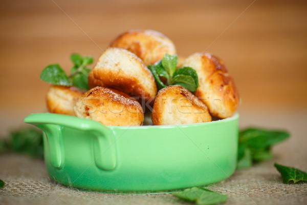 Kicsi pörkölt édes fánkok porcukor konyha Stock fotó © Peredniankina