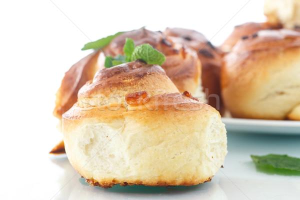 édes tekercsek mazsola fehér háttér torta Stock fotó © Peredniankina