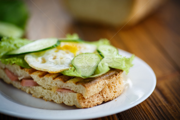 sandwich with sausage, cheese, lettuce and eggs Stock photo © Peredniankina