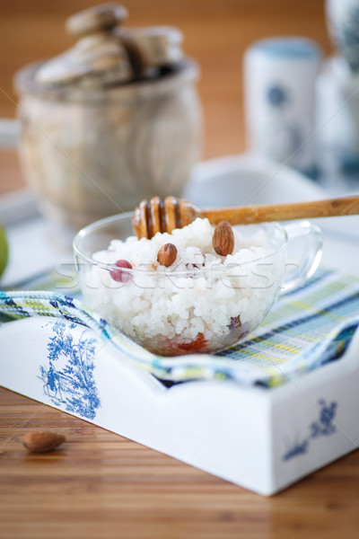rice porridge with nuts and honey Stock photo © Peredniankina