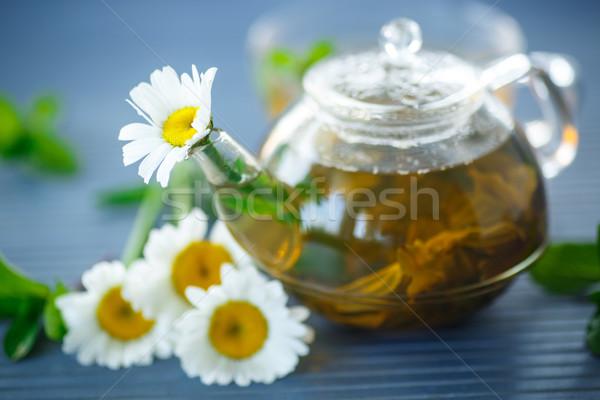 Сток-фото: ромашка · чай · таблице · цветы · стекла