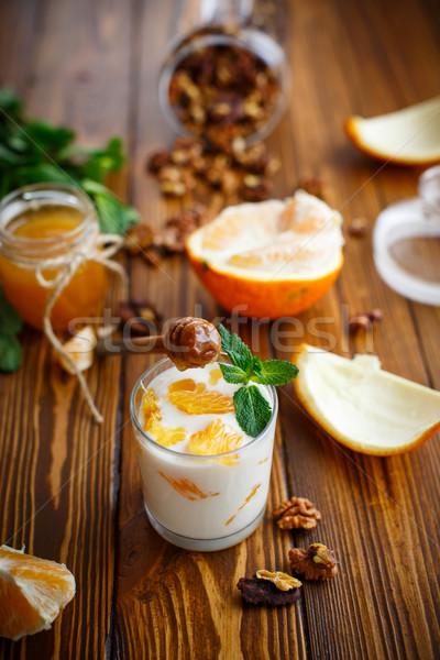 Griego yogurt miel naranjas vidrio fondo Foto stock © Peredniankina
