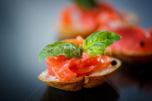 Szendvics sózott lazac sötét hal asztal Stock fotó © Peredniankina