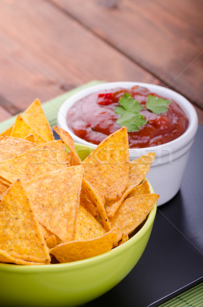 Tortilla chips with spicy tomato salsa Stock photo © Peteer