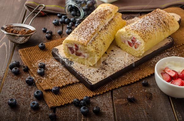 Stock photo: Sponge roll stuffed with strawberry cream