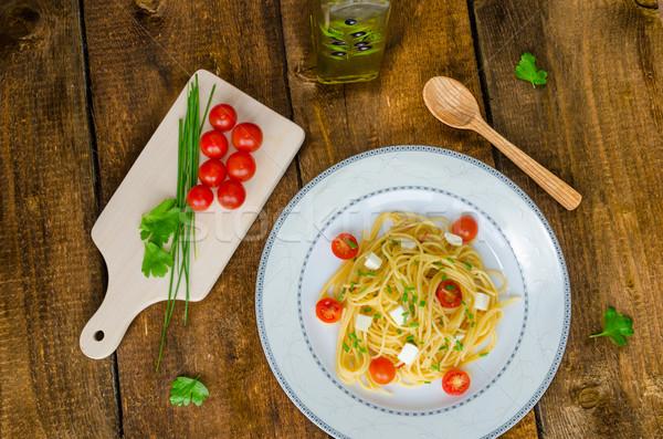 Spagetti koktélparadicsom mozzarella olívaolaj étel fény Stock fotó © Peteer