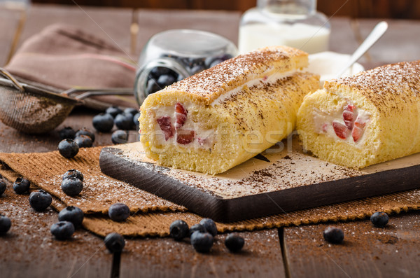 Sponge roll stuffed with strawberry cream Stock photo © Peteer