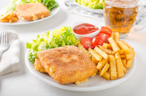 Fried cheese with french fries and lettuce Stock photo © Peteer