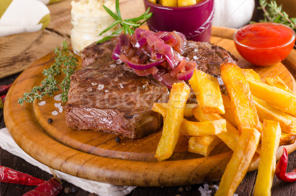 Beef steak with homemade french fries, beer and tartar sauce Stock photo © Peteer