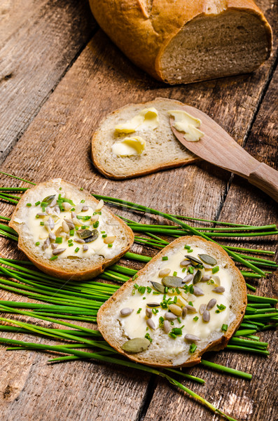Homemade bread buttered with healthy seeds and herbs Stock photo © Peteer