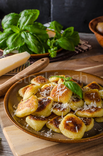 Crispy gnocchi with cheese and herbs Stock photo © Peteer