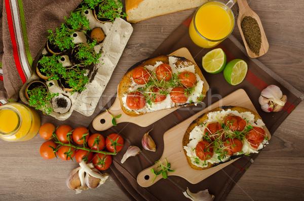 Roasted Cherry Tomato Sauce and Ricotta on Toast Stock photo © Peteer