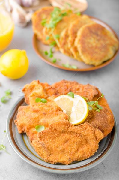 Delicious original schnitzel with potato pancakes Stock photo © Peteer