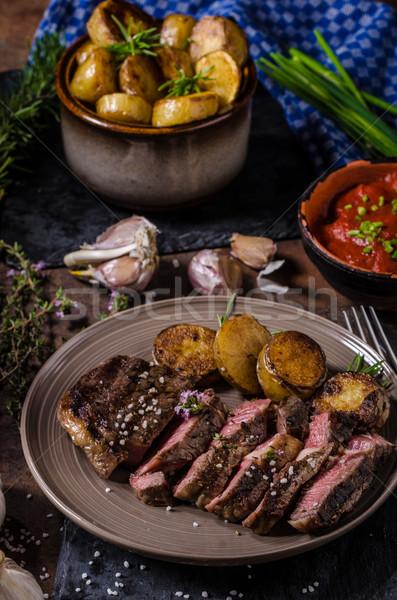 Costela olho bife ervas batatas Foto stock © Peteer