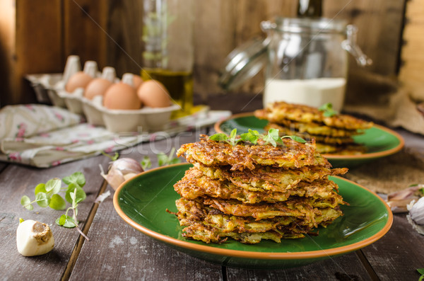 Stock photo: Potato pancakes with garlic and beer