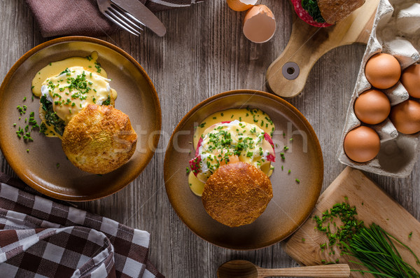 Egg benedict with hollandaise sauce Stock photo © Peteer