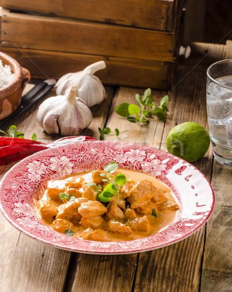 Caril de frango ervas velho estilo prato rústico Foto stock © Peteer