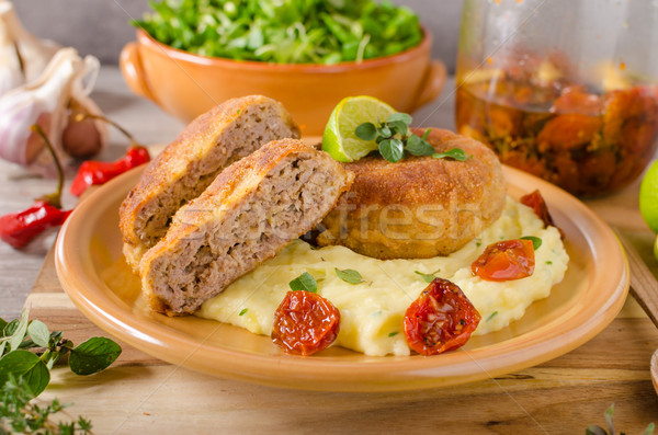 Minced meat schnitzel with cheese Stock photo © Peteer