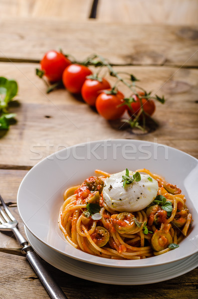 Italian pasta with poached egg Stock photo © Peteer