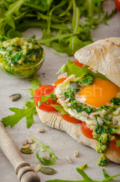 Ciabatta with fried egg, tomatoes and pesto Stock photo © Peteer