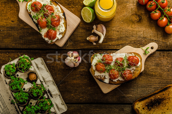Roasted Cherry Tomato Sauce and Ricotta on Toast Stock photo © Peteer