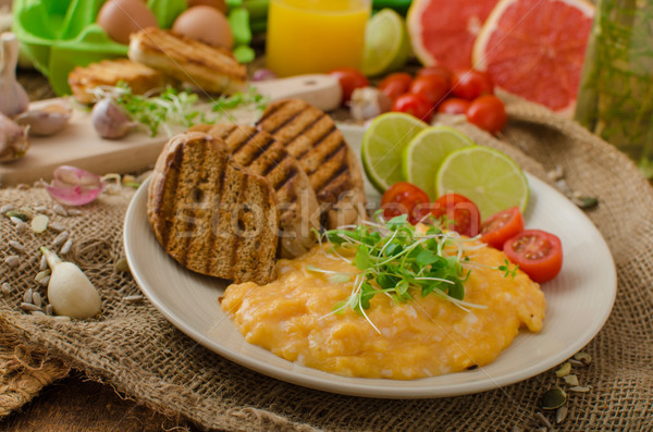 Scrambled eggs, creamy and fluffy Stock photo © Peteer