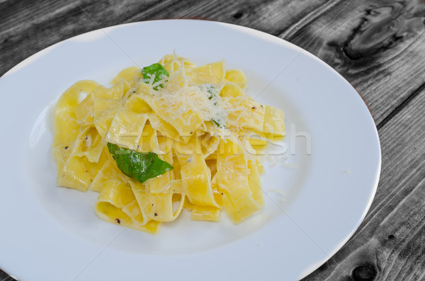 Fresh pappadelle pasta with lemon, basil and creame Stock photo © Peteer