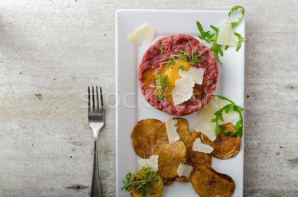 Beef tartar, potato chips Stock photo © Peteer