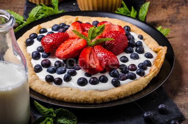 Crispy cake with cream and berries Stock photo © Peteer