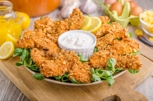 Chicken strips with delish garlic dip Stock photo © Peteer