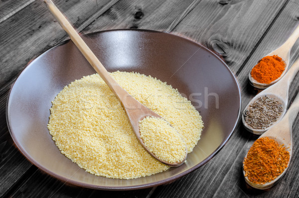 Spice on spoon with bowl of couscous Stock photo © Peteer