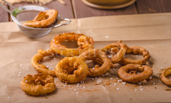 Onion rings with chili on top Stock photo © Peteer