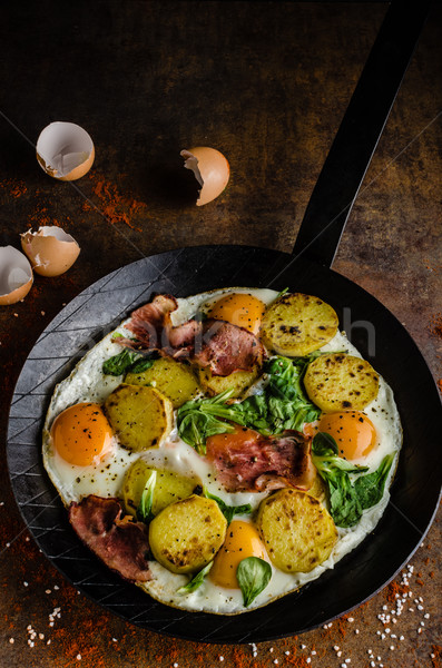 Rustic omelette fried eggs Stock photo © Peteer