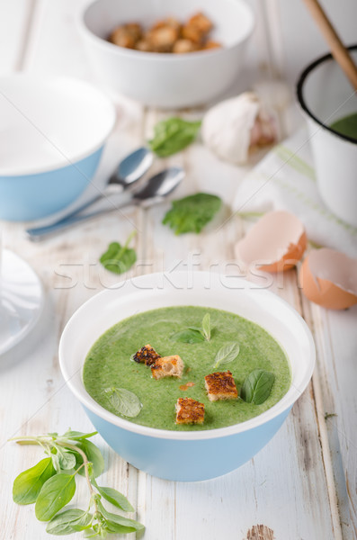 Spinach soup with poached egg Stock photo © Peteer