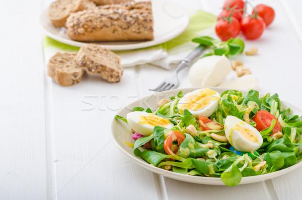 Lechuga ensalada huevos nueces girasol calabaza Foto stock © Peteer