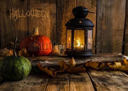Halloween pumpkin moody picture with lantern Stock photo © Peteer
