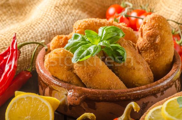 Chicken schnitzel with croquettes Stock photo © Peteer