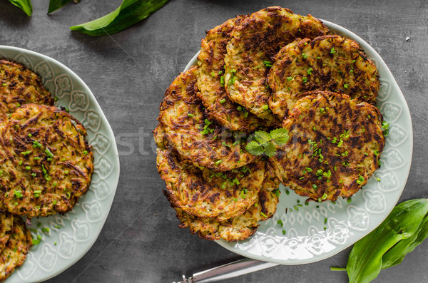 Potato pancakes fried with garlic Stock photo © Peteer