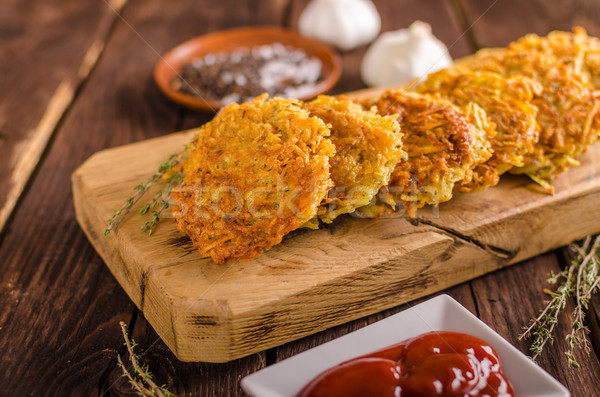 Delish potato pancakes with ketchup Stock photo © Peteer