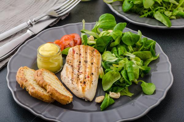 Frango grelhado salada nozes peito alface torrado Foto stock © Peteer