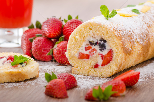 Sponge roll with strawberries and blueberries Stock photo © Peteer