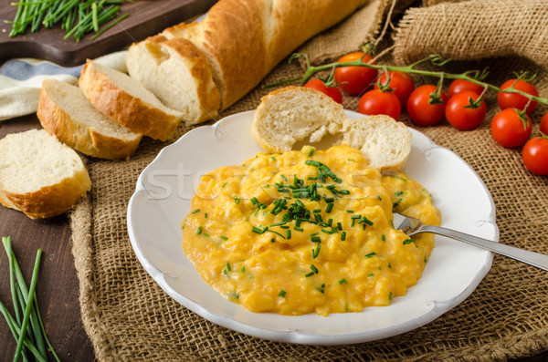 French style scrambled eggs with chives Stock photo © Peteer