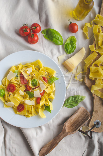 Tagliatelle in Italian colors, roasted tomatoes, basil Tagliatelle Stock photo © Peteer