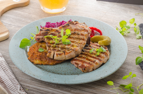 Grilled pork chops with herbs and garlic, potato pancakes Stock photo © Peteer