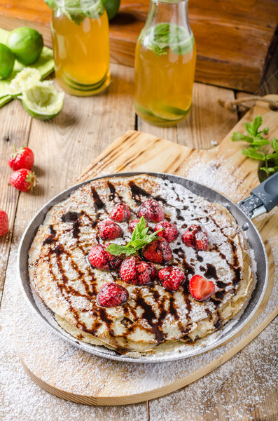 Crepes with fruit and chocolate Stock photo © Peteer