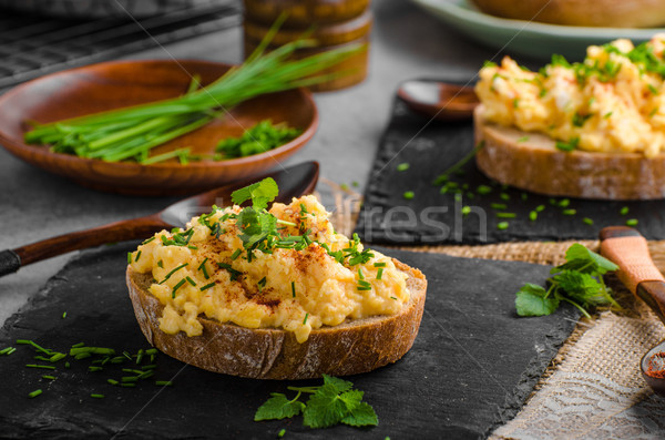 Scrambledd eggs with chive and chilli Stock photo © Peteer