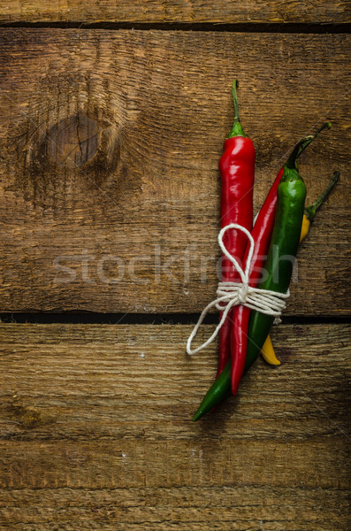 Chilli peppers, wood table, background Stock photo © Peteer