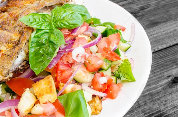 Stock photo: Chicken under a brick with panzanella salad